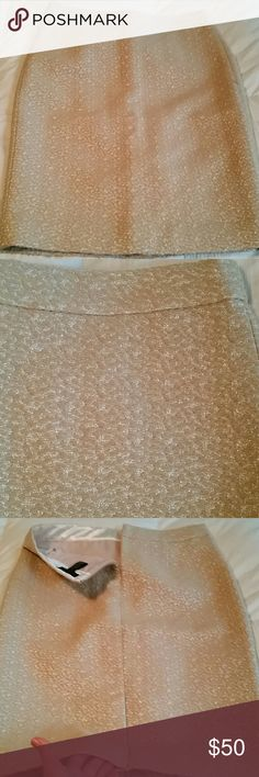 JCrew Collection metallic pencil skirt NWOT! Stunning gold metallic fabric in wool/silk blend. Pencil style, fully lined, with back zipper and vented hem - still stitched closed! 16.5 inches across at waist, 23.5 inches long. In perfect condition! J. Crew Skirts Pencil