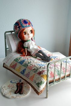 Chillin', via Flickr.  I love the bed and the quilt and her crochet hat.