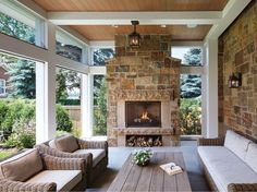 A cozy screen porch with a fireplace offers glimpses of Lake of the Isles.