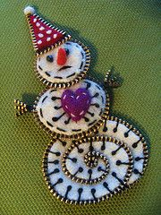 http://www.flickr.com/photos/woolly_fabulous/page10/  zipper snowman