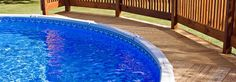 With the money you save by getting an above ground pool, you can install a wraparound deck that improves its looks and functionality. Some above ground pools with decks are even difficult to distinguish from inground pools. Above Ground Pool Prices, Cleaning Above Ground Pool, Above Ground Pool Heater, Installing Above Ground Pool, Above Ground Pool Liners, Above Ground Pool Decks, Above Ground Swimming Pools, In Ground Pools, Hidden Water Pool