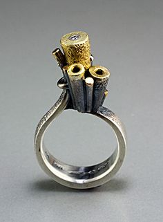 ring with tall tubes and a diamond