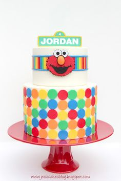 elmo kids cake sesame street - pretty classy for an elmo cake, I like the polka dots but not sure if more than the randomly placed different-sized ones, white background, the stripe with stripes inside is cute