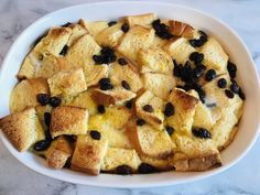 A decadent and classic dessert, this Easy Christmas Bread Pudding has a thick bread base with raisins and then topped with a white brandy sauce. Raisin Bread Pudding, Brandy Sauce, Christmas Bread, 2 Quart Baking Dish, Classic Desserts, Easy Cake Recipes, Pudding Recipes, Christmas Desserts