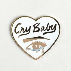 "Your favorite Cry Baby Patch now comes in a pin! Show 'em you're weepy & proud. Details - 1.75"" x 1.75"" size - Cloisonné hard enamel set in 22kt plated gold - Rubber clutch clasp - Illustrated & © by"