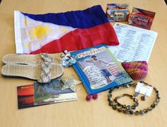 Hope you enjoyed World Refugee Day! We're back with culture kits of the day! Today is Philippines! We have two kits and this is the first so be sure to check out the second kit. Our Philippines kit has many items like shoes, paper earrings, a jewelry set, a laminated food menu, postcards, a Philippines map, a coin purse, a Spotify playlist of Filipino music, photos of currency, and the national flag.