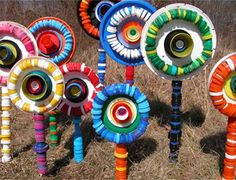 Decorate the yard with art from all the old collected and cleaned bottles and…