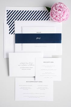 Classic navy blue striped wedding invitations with an urban feel and plus sign monogram