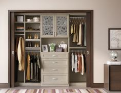 Complete With Chic Sliding Doors This Reach In Closet Reveals An Elegant Storage Solution