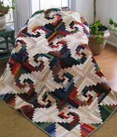 Shenandoah Log Cabin made by Rhonda Byrd. Pattern designed by Judy Martin is in Cookies 'n' Quilts, 2001. Rhonda changed the colors and the pieced border--lovely!