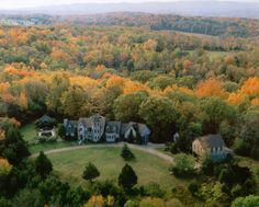 Aerial shot of the property. The home sits on 11.6 acres of protected woodland. With the exception of the lawn in front, the rest of the property is composed of hard woods and evergreens. There is a lot of cedar growing in the front side of the property which stays green through the winter. Cedar also scents the air beautifully.