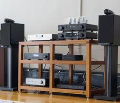 One big happy family: @bowerswilkins speakers, @peachtreeaudio amp, @wooaudio headphone amp, @rotelhifi music systems, @bluesoundhifi media streamer, #transparentaudio powerbank, all on a @boxfurniture double width rack. . . . . #audiophile #hifi #musicsystem #highendaudiostore #highendaudioequipment #sound #peachtreeaudio #bowersandwilkins #wooaudio #boxfurniture #transparentaudio #bluesound #rotel