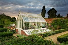 A Scotney greenhouse from the National Trust collection in Tom Hoblyn's own garden. Cold frames down the side work really well here. www.alitex.co.uk