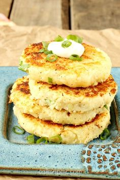 Mashed Parmesan Potato Cakes have a crispy outside and fluffy creamy inside. Enjoy them plain or loadsimilar to loaded potato skins with cheddar bacon green onions and ranch dressing. Parmesan Mashed Potatoes, Mashed Potato Cakes, Leftover Mashed Potatoes, Cheesy Potatoes, Potato Recipes, Vegetable Recipes, Potato Dishes, Potato Skins, Food Dishes