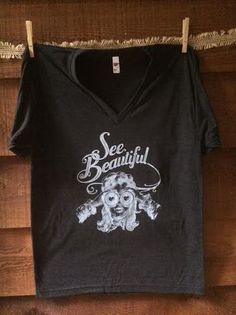 This design has been two years in the making! Our See Beautiful woman focuses her attention on finding love, kindness, and goodness in the world. It is an intention we hope all who join our See Beautiful Community walk away seeing, believing and living. Charcoal See Beautiful Tri-Blend T-shirt $28