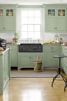 10 Paint Colors to Try If You Dream of a Green Kitchen Colorful Cabinets: The kitchen in this beach house feature cabinets painted in a light green shade to complement the warm wooden floors. Light Green Kitchen, Green Kitchen Decor, Green Kitchen Cabinets, Painting Kitchen Cabinets, Kitchen Ideas, Kitchen Wood, White Cabinets, Diy Kitchen, Floors Kitchen