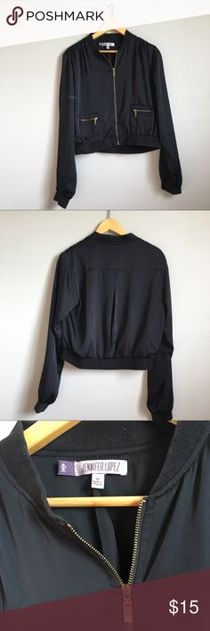 Jennifer Lopez Black Bomber with gold zipper Jennifer Lopez Black Bomber with gold zipper. Highlight in the photo it isn't a mark. Great condition. Jennifer Lopez Jackets & Coats