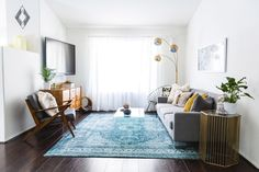 """gravityhome: """" Mid-century home   shop the look: buffet - chair - blue rug - acapulco chair - clear coffee table - clear side table - woodslice table - bench with drawers - table lamp - round mirror - hanging planter - round hanging planter - knitted..."""