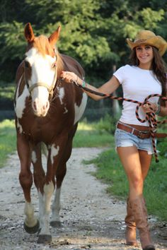 Ok, I have a paint horse and the same hat...I have boots too and at one time I had jean shorts and a white T...so yeah, at one time this COULD have been me ;> It's the me that's inside still -  blonder hair tho, LOL