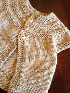 Ravelry: in threes: a baby cardigan pattern by Kelly Herdrich- I love this. Hoping to make it someday!FREE Workshop: In Threes--A Baby Cardigan Even if you've never made a sweater, you'll fall in love with knitting this SWEET baby sweater. Baby Cardigan, Cardigan Bebe, Baby Girl Cardigans, Knit Baby Sweaters, Cardigan Pattern, Baby Knits, Toddler Cardigan, Sweater Patterns, Winter Cardigan