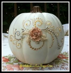 pumpkin decor for a wedding | flower bouquet drill holes and add a candle for a polka dot effect ...