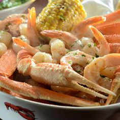 Crab and Roasted-Garlic Seafood Bake --  Steamed snow crab legs paired with tender shrimp and bay scallops roasted in a garlic and white wine broth. Served with sweet corn on the cob and red potatoes.
