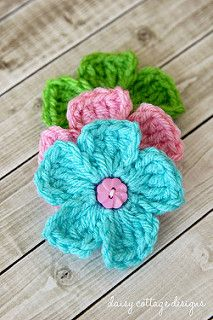 This adorable little flower pattern is easy to work up. It's perfect for babies, embellishing hats, and gluing to other fun projects.