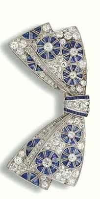 Princess Margaret's Sapphire & Diamond Bow Brooch. Bow brooch is pavé-set diamond bow decorated w/ openwork sapphire, diamond wheel motifs & calibré-cut sapphire detail. Mounted in platinum & gold. Approximately 5.6 cm. wide. Circa 1920. It's not known how or when it came to be in possession of HRH Princess Margaret. Brooch, along with many of Princess Margaret's Jewels, was sold during a Christie's London auction in 2006. It sold for $37, 536. No information available as to the new owner.