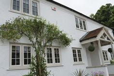 Timber Alternative Windows installed in Oakely Green, Windsor Berkshire White Exterior Houses, Cottage Exterior, House Paint Exterior, Exterior House Colors, Cottage Front Doors, Cottage Windows, Cottage Porch, Green Windows, Timber Windows