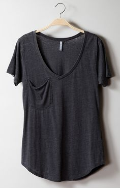 This versatile tee features a low V-neckline, a slouchy pocket and a rounded hemline. The long hemline sits at or below the hips which allows this tee to be layered with vests and sweaters or paired w Frock Fashion, Warm Weather Outfits, Slouchy Tee, T Shirts For Women, Clothes For Women, Clothing Items, Casual Chic, Dress To Impress, What To Wear
