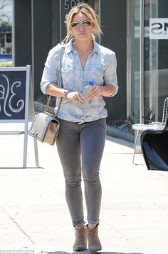 Showing off the fruits of her labour: Hilary Duff highlighted her shapely legs in skintigh...