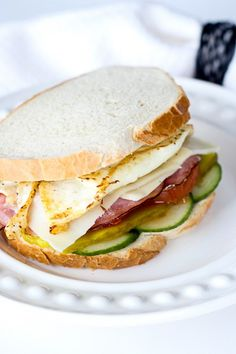 Breakfast sandwich with ham, eggs, cheese and vegetables.
