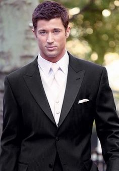 groom= white vest, white tie, black jacket. very classy :)