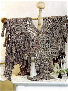 Elegant capelet is made with fine (sport) weight yarn and size G hook.  Designed by Margaret Hubert