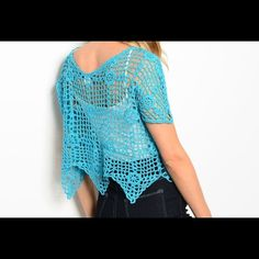 """CUTE BLUE CROCHET TOP Love this cute blue short sleeve top for summer. Features a crochet design and scalloped hem.  Fabric Content: 55% COTTON 45% POLYESTER  Size measurements-- L: 18"""" B: 20"""" W: 20"""". This is a one size fits small to large Tops"""