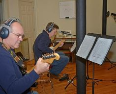 Brian and Rob guitar duo for PV at NH Tunes.