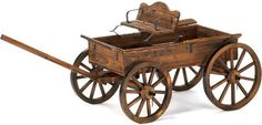 Rustic Wagon. This is a very functional buckboard wagon with working wheels. Use it as a work horse in your garden or as a big toy wagon with children or pets or simply lending its antique feel to your yard when not needed. Fir wood. 64 x 37.5 x 26.5 inches high.