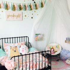 Girly girl room. IKEA toddler bed. Target bedding. IKEA canopy made into a reading nook.
