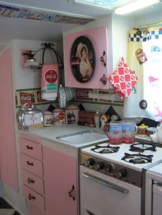 I do not like Coke collectibles, but I love these pink cabinets (and Coke in the can).