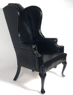perfectly patinated black leather wing chair