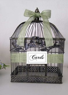 birdcage! We used this for our wedding; to hold gift envelopes/ cards.  Nice accents for rustic touch. Approved!