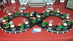 Close up of Disney Cars inspired dessert table with cupcakes on race track