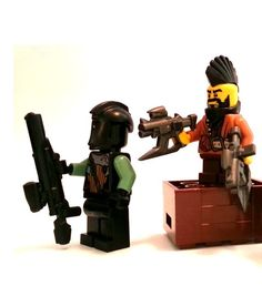 Skewer SMG - The Skewer SMG is an unusually-shaped custom LEGO gun. It's not even completely clear how your minifig is supposed to hold it. But this mohawk-ed minifig below is showing you how it's done; and he's double fisting. The unusual shape comes from the gun's name-sake, skewer, protruding from below the barrel of the gun. It's like a new age bayonet. #LEGO #Minifigure #BrickWarriors #Skewer #Mohawk #SciFi #SMG #bayonet #LEGOAccessories #MinifigureAccessories