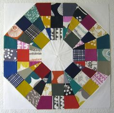 Free pattern on Modern Quilt Guild blog.  Saw this earlier with an orange colorway.  easier to see the pattern on that one, but these scrappy colors are inspirational.