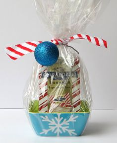 Slip a bag of Ghiradelli peppermint chocolates in a fun Target melamine bowl and wrap with cellophane.  Inexpensive holiday gift.