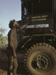 One of the Pintupi Nine examines a truck belonging to the Royal Geographical Society of the University of Melbourne.