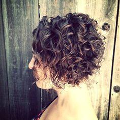 asymmetrical curly messed bob