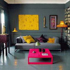 Bold Morroccan hues on contemporary pieces pop against soothing gray walls.
