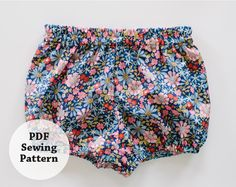 One part comfy and the other sweet -- the perfect recipe for a summer bloomer. This pattern is whips up quickly and with little yardage. Choose a variety of fabrics and patterns to build a stash of bloomers for your little one. Directions include full-color photos of entire process. Difficulty Level: Beginner This pattern available in sizes: 0-6M, 6-12M, 12-18M, 18-24M, 2T, 3T There are two downloads: the directions and the pattern pieces Share your project using #whitneydeal…