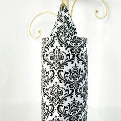 Plastic bag holder   http://www.etsy.com/listing/65785535/plastic-grocery-bag-holder-black-and
